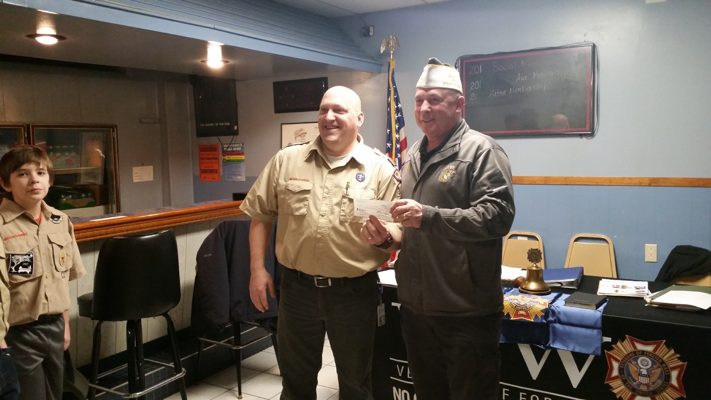Commander Staudt presents donation to Troop Leader